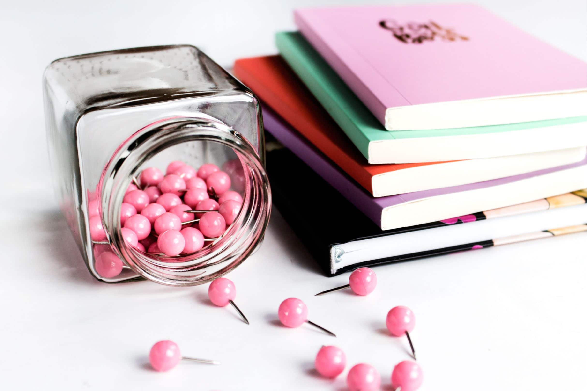 notebooks and pink push pins in home office