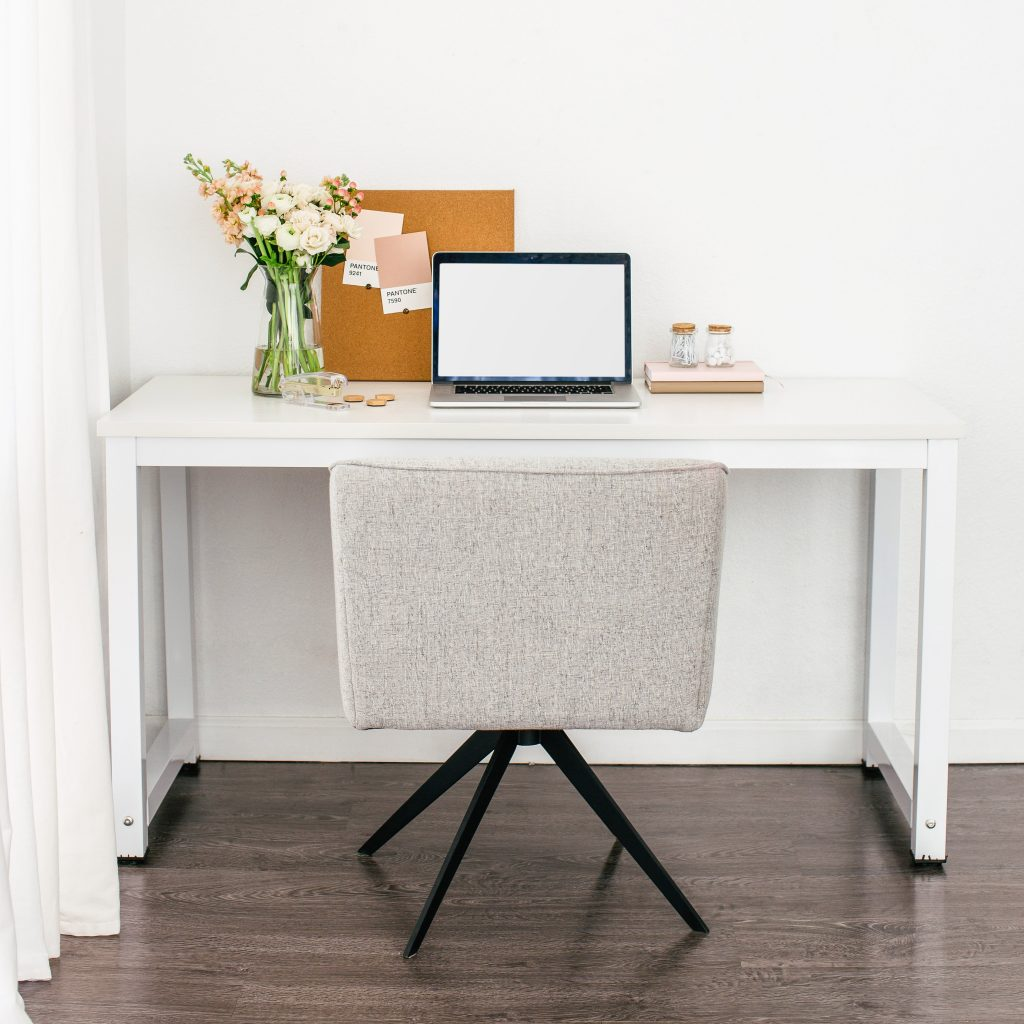 Desk with laptop and flowers