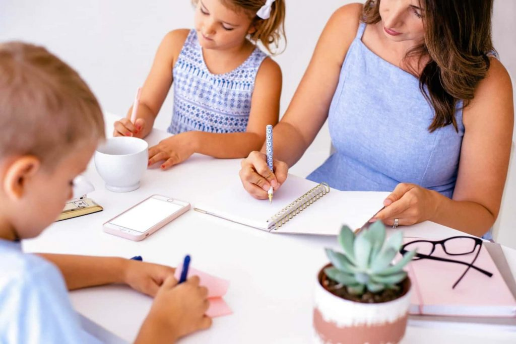 mom working with kids from home office