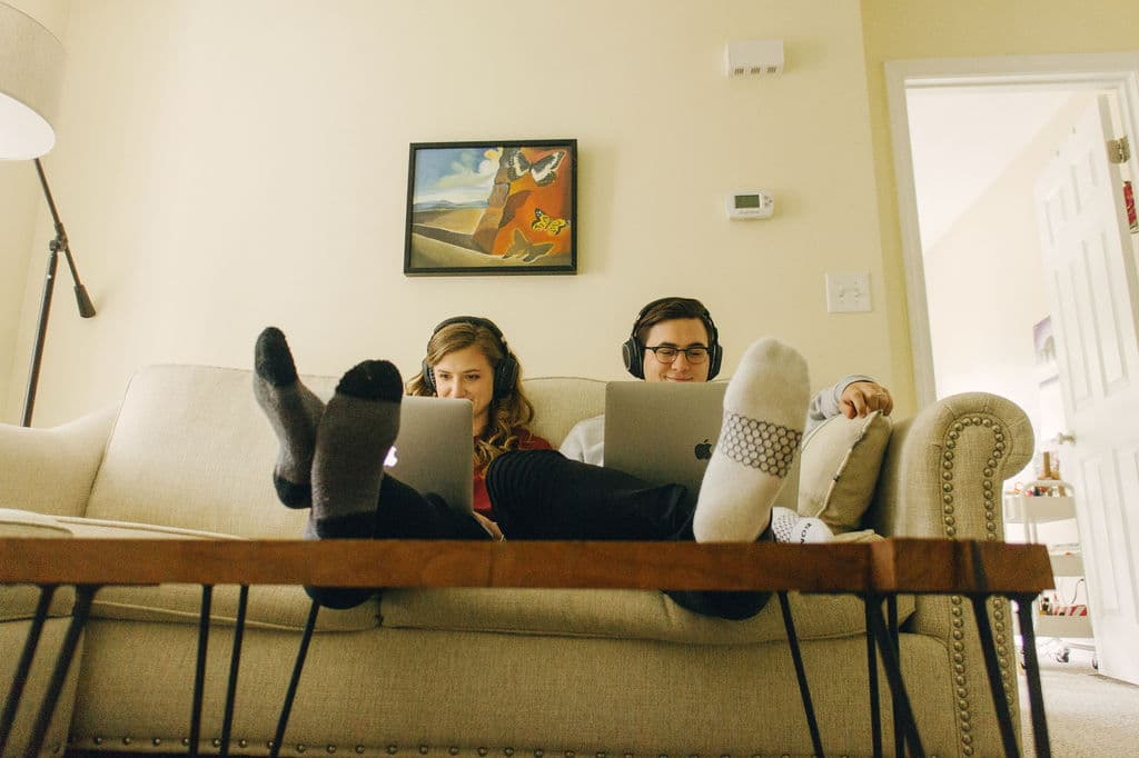 Two people sitting on couch
